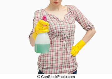 Close up of a woman holding a spray bottle