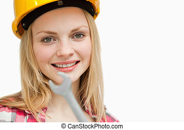 Close up of a woman holding a wrench