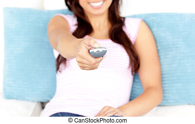 close up of a woman holding remote