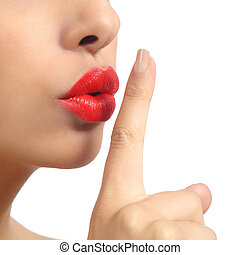 Close up of a woman lips with finger asking for silence