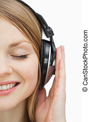 Close up of a woman listening music