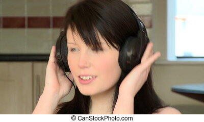 Close-up of a woman listening music