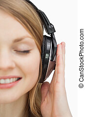 Close up of a woman listening music while smiling