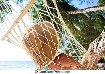 Close-up Of A Woman Lying On Hammock At Beach