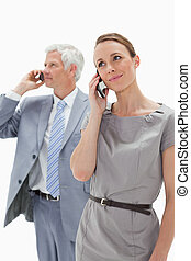 Close-up of a woman making a call with a white hair...