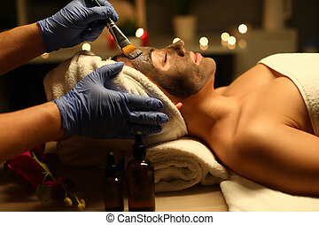 Close-up of a woman performing therapeutic procedures in a health Spa. Body care in a luxurious massage Spa.