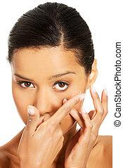 Close up of a woman putting contact lens
