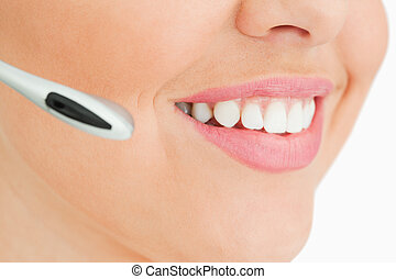 Close-up of a woman smiling working in call center