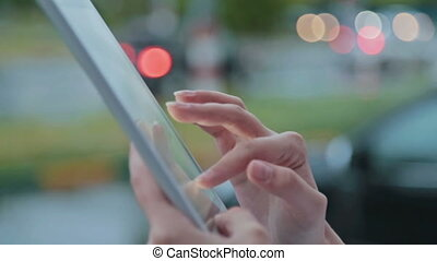 Close up of a woman using tablet pc