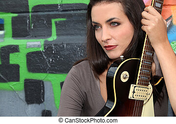 close-up of a woman with guitar