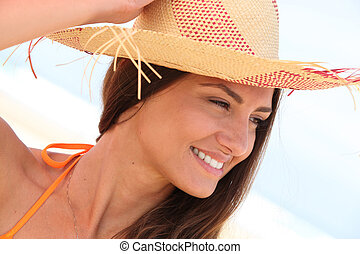 close-up of a woman with hat