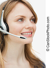 Close up of a woman with headset smiling