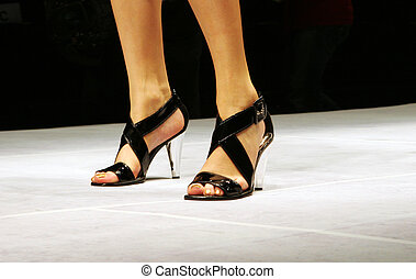 Close-up of a woman's shoes.