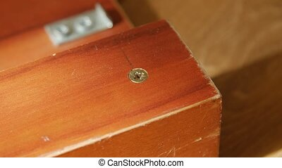 Close up of a wood screw. - Close up of a wood screw being...