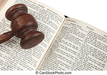 Close up of a wooden judge's gavel on an 1882 bible.