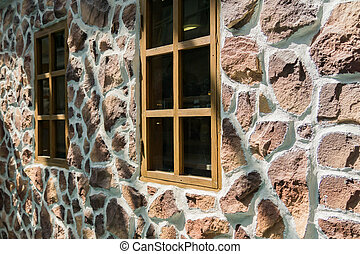 close up of a wooden windows on stone wall