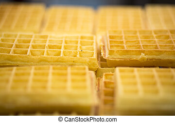 Close up of a yellow waffles with selective focus.
