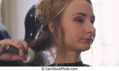Close up of a young blonde woman in luxury beauty parlour...