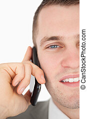 Close up of a young businessman making a phone call