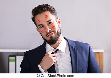 Businessman With Lipstick Kiss Marks On Face