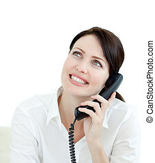 Close-up of a young businesswoman on phone