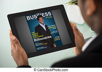 Businesswoman Reading Online Magazine