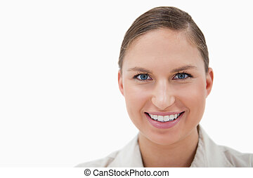 Close up of a young businesswoman smiling at the camera