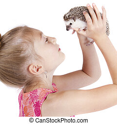 Close up of a young girl holding her pet hedgehog