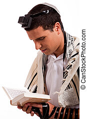 Close up of a young jewish man with book on white isolated background