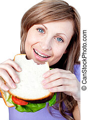 Close-up of a young woman eating a