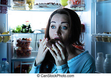 Close-up Of A Young Woman Eating Donut