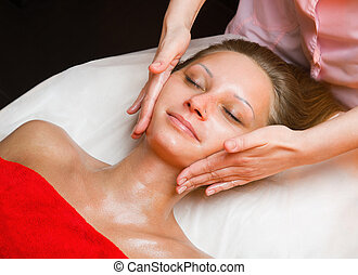 Close-up of a Young Woman Getting massage