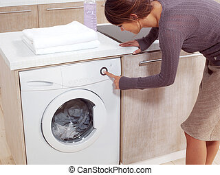 putting a cloth into washing machine
