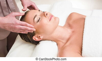 Close up of a young woman receiving head massage