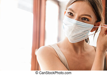 Close up of a young woman wearing medical mask