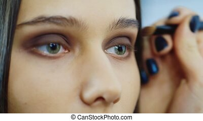 Close-up of a young woman: where to apply makeup