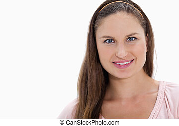 Close-up of a young woman with dark blonde hair smiling
