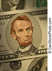 Close-up of Abraham Lincoln on the $5 bill, dramatically lit...