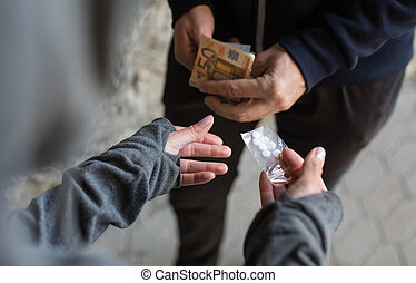 close up of addict buying dose from drug dealer