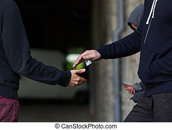 close up of addict buying dose from drug dealer - drug...