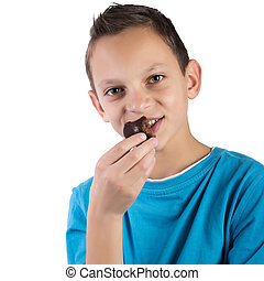 Adorable boy eating cookies