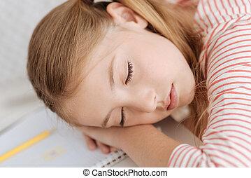 Close up of adorable girl having nap