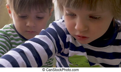 Close up of adorable young boy and girl playing and concentrating together