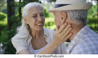 Close-up of affectionate senior couple talking - Close-up of...