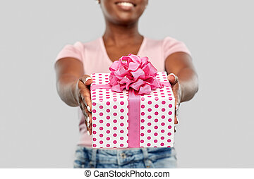 close up of african american woman with gift box