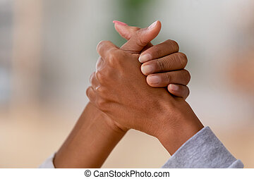 Close up of african females arm wrestling