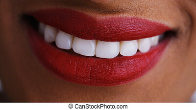 Close up of african woman smiling and kissing