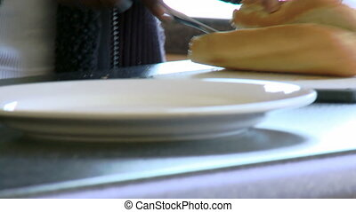 Afro-American woman cutting bread - Close-up of...