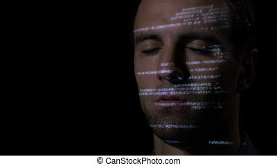 Close up of ai software developer man with beard keeping his eyes closed and moving his head while programming code is reflected on his face
