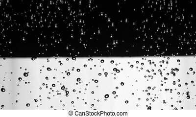 Close up of air bubbles in the underwaterisolated on black and white background. Slow motion